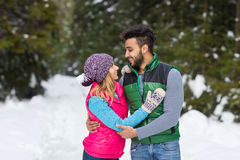 Young Mix Race Couple Embrace Snow Forest Outdoor Winter Walk Royalty Free Stock Photos