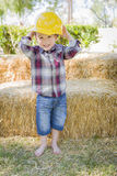 Young Mixed Race Boy Laughing with Hard Hat Outside stock images