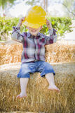 Young Mixed Race Boy Laughing with Hard Hat Outside royalty free stock photo