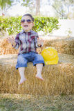 Young Mixed Race Boy Laughing with Sunglasses and Hard Hat Stock Photo
