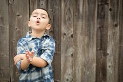 Young Mixed Race Boy Making Hand Gestures Royalty Free Stock Photo