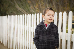 Young Mixed Race Boy Waiting For School Bus Along Fence Outside Royalty Free Stock Photo