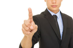 Young mixed race businessman pointing with index finger Royalty Free Stock Photography