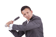Young mixed race businessman swinging his baseball bat Royalty Free Stock Photography