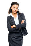 Young mixed race businesswoman with arms folded isolated white b Royalty Free Stock Image