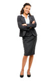 Young mixed race businesswoman with arms folded smiling isolated Royalty Free Stock Photos