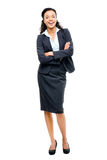 Young mixed race businesswoman with arms folded smiling isolated Royalty Free Stock Image