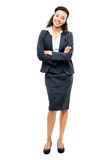 Young mixed race businesswoman with arms folded smiling isolated Stock Images