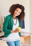 Young mixed race businesswoman smiling with a cup of coffee Stock Photography