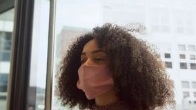 Young Mixed Race Businesswoman Wearing Face Mask Entering Office Building During Covid-19 Pandemic