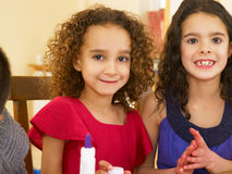 Young mixed race children doing handicrafts royalty free stock image
