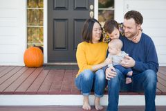 Young Mixed Race Chinese and Caucasian Family Portrait. On Their Front Porch Royalty Free Stock Photos