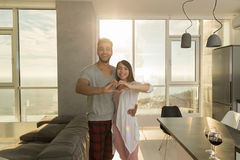 Young Mixed Race Couple Apartment Panoramic Window Sea View Morning, Happy Hispanic Man Asian Woman Embracing Royalty Free Stock Photo