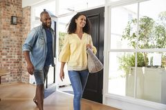 Young mixed race couple arriving at home royalty free stock photography