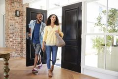 Young mixed race couple arriving at home stock images