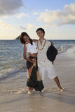 Young mixed race couple at the beach Royalty Free Stock Photos