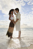 Young mixed race couple at the beach. In hawaii at sunrise stock images