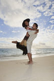 Young mixed race couple at the beach. In hawaii at sunrise stock photo