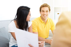 Young mixed race couple meeting with consultant Stock Photo