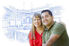 Young Mixed Race Couple Over Kitchen Design Drawing on White Royalty Free Stock Photos