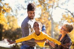 Young mixed race couple spending time with their daughter. Happy young mixed race couple spending time with their daughter Royalty Free Stock Image