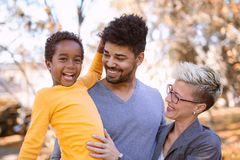 Young mixed race couple spending time with their daughter Stock Photos