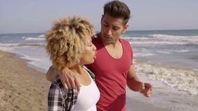 Young Mixed-Race Couple Standing On The Beach stock footage