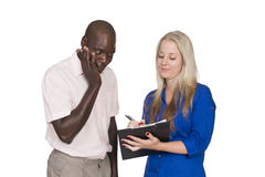 Young mixed race couple with tablet Stock Images