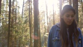 Young Mixed Race Female Hipster Walking Between Pine Trees. Asian Girl Hiking in Beautiful Autumn Forest full of Green. Moss. Lifestyle Slowmotion 4K Footage stock footage