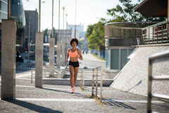 Young mixed race fitness woman model running Stock Images