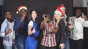 Young Mixed race friends dancing at Christmas party in studio. stock video footage