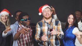 Young Mixed race friends dancing at Christmas party in studio. stock video