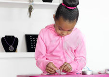Young girl working jewelry counter. Young mixed race girl working jewelry counter Stock Image