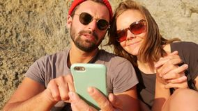 Young Mixed Race Hipster Shows Girlfriend How to Install New App On Her Mobile Phone. HD Slowmotion.