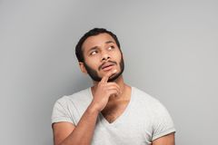 Young mixed race man looking up Royalty Free Stock Images