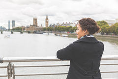 Young mixed race woman on a bridge in London Stock Photography