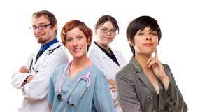 Young Mixed Race Woman with Doctors and Nurses Behind Royalty Free Stock Images