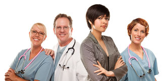 Young Mixed Race Woman with Doctors and Nurses Behind Stock Image