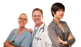 Young Mixed Race Woman with Doctors and Nurses Behind Royalty Free Stock Photo