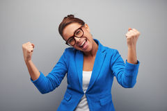 Young mixed race woman gains a victory Stock Photo