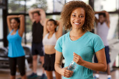 Young mixed-race woman in a gym. Young mixed-race women in a gym preparing to exercise Royalty Free Stock Photos