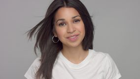 Young mixed race woman in studio in casual look stock footage