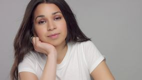 Young mixed race woman in studio in casual look stock video