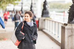 Young mixed race woman walking in London Royalty Free Stock Photography