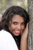 Young mixed teen girl outdoor portrait tree Royalty Free Stock Photos
