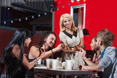 Young Lady Sharing Pizza Stock Images