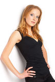 Young Model. Portrait of a young red-haired model posing over white Stock Photography