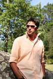 Young Model. Attractive young model with white frames sunglasses in the park Stock Photography
