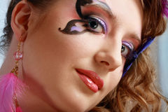 Young model beauty women. Young model beautyful woman with perfect butterfly make up and hairstyle clouse-up Royalty Free Stock Image