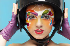 Young model with bright creative make up with helmet Royalty Free Stock Photography